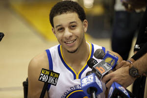 Photo - Golden State Warriors' Seth Curry smiles as he answers questions during NBA basketball media day on Friday, Sept. 27, 2013, in Oakland, Calif. (AP Photo/Marcio Jose Sanchez)