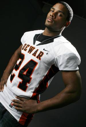 Photo - HIGH SCHOOL FOOTBALL: All State football player Ronnell Lewis, Dewar, in the OPUBCO studio, Wednesday, Dec. 17, 2008. BY NATE BILLINGS