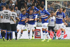 Photo - Sampdoria defender Shkodran Mustafi, center, is congratulated by his teammates after he scored a goal during a Serie A soccer match between Sampdoria and Atalanta, in Genoa, Italy, Saturday, Oct. 26, 2013. (AP Photo/Carlo Baroncini)