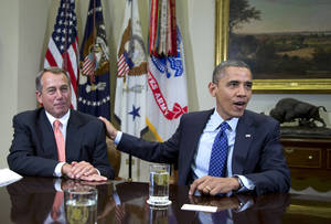 "Photo -   FILE - In this Nov. 16, 2012, file photo, President Barack Obama acknowledges House Speaker John Boehner of Ohio while speaking to reporters in the Roosevelt Room of the White House in Washington, as he hosted a meeting of the bipartisan, bicameral leadership of Congress to discuss the deficit and economy. A big coalition of business groups says there must be give-and-take in the negotiations to avoid the ""fiscal cliff"" of massive tax hikes and spending cuts. But the coalition also says raising tax rates is out of the question. The group doesn't care that President Barack Obama campaigned to raise tax rates on the rich. The same song is sung by groups representing retirees, colleges and countless others. (AP Photo/Carolyn Kaster, File)"