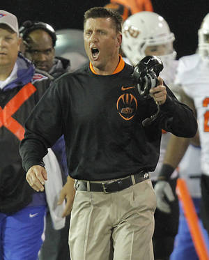 Photo - Oklahoma State coach Mike Gundy yells at the officials during a college football game between the Oklahoma State University Cowboys and the University of Tulsa Golden Hurricane at H.A. Chapman Stadium in Tulsa, Okla., Sunday, Sept. 18, 2011. Photo by Chris Landsberger, The Oklahoman