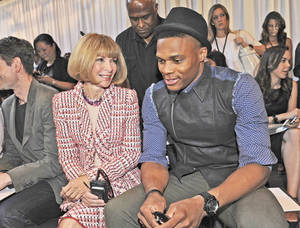 Photo - Thunder guard Russell Westbrook, right, and Vogue's Anna Wintour, left, attended the Rag & Bone Spring 2014 collection show during Fashion Week in New York. AP photo