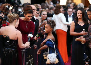 Photo - Actress Quvenzhane Wallis arrives at the Oscars at the Dolby Theatre on Sunday Feb. 24, 2013, in Los Angeles. (Photo by Matt Sayles/Invision/AP)