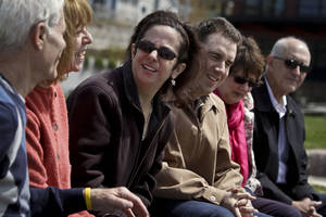 Photo - Hava Samuels, third from left, and her husband Paul Farziano, third from right, sit with their parents Norman Samuels, far left and Bonnie Samuels, second from left, and Frank Farziano, far right, and Rosann Farziano, second from right,  during an interview on Thursday, April 25, 2013 in Port Jefferson, N.Y.   Paul and Have, a developmentally disabled couple, has brought a lawsuit against the group facilities where they live for violating the Disability Act, by refusing them residence as a married couple.  (AP Photo/Bebeto Matthews)
