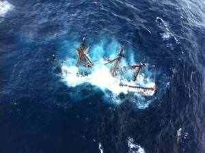 Photo - The U.S. Coast Guard shows the HMS Bounty, a 180-foot sailboat, submerged in the Atlantic Ocean during Hurricane Sandy approximately 90 miles southeast of Hatteras, N.C., Monday, Oct. 29, 2012. The Coast Guard rescued 14 of the 16 crew members by helicopter. Hours later, rescuers found Claudene Christian, one of the missing crew members, but she was unresponsive. She was later prounounced dead. They were still searching for the captain. (AP Photo/U.S. Coast Guard, Petty Officer 2nd Class Tim Kuklewski)