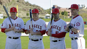Photo - Los Angeles Angels' Mark Trumbo, left to right, Mike Trout, Albert Pujols and Josh Hamilton pose for photographers during photo day before a spring training baseball workout Thursday, Feb. 21, 2013, in Tempe, Ariz. (AP Photo/Morry Gash)