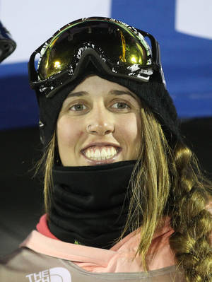 Photo - First-place finisher Maddie Bowman celebrates on the podium following the women's U.S. Grand Prix freestyle halfpipe skiing event on Friday, Jan. 17, 2014, in Park City, Utah. (AP Photo/Rick Bowmer)