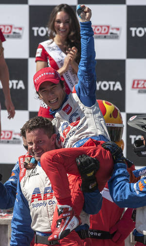 Photo - Takuma Sato of Japan celebrates after winning the IndyCar Series' Long Beach Grand Prix auto race, Sunday, April 21, 2013, in Long Beach, Calif. (AP Photo/Ringo H.W. Chiu)