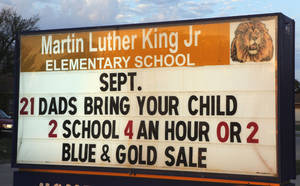 photo - Dads dropping off their kids at Martin Luther King Elementary School as part of Take Your Child to School Day, Friday, September 21, 2001.   Six Oklahoma City Public Schools will be part of the inaugural event. Photo By David McDaniel/The Oklahoman