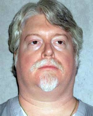 Photo - This June 29, 2011, photo provided by the Oklahoma Department of Corrections shows Kenneth Hogan. Convicted of first-degree murder and sentenced to die for the January 1988 stabbing death of Lisa Stanley at Stanley's home in Oklahoma City, Hogan is scheduled to be executed Jan. 23, 2014. (AP Photo/Oklahoma Department of Corrections)