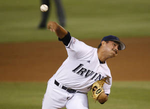 Photo - UC Irvine Andrew Morales pitches in the first inning of an NCAA college baseball tournament super regional game against Oklahoma State in Stillwater, Okla., Saturday, June 7, 2014. (AP Photo/Sue Ogrocki)