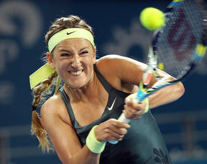 photo - Victoria Azarenka of Belarus plays a shot in her second round match against Sabine Lisicki of Germany during the Brisbane International tennis tournament in Brisbane, Australia, Wednesday, Jan. 2, 2013.  (AP Photo/Tertius Pickard).