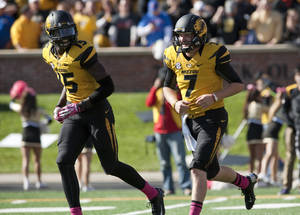 Photo - Missouri quarterback Maty Mauk, right, laughs with teammate Dorial Green-Beckham, left, after Mauk scored a touchdown during the fourth quarter of an NCAA college football game against Florida Saturday, Oct. 19, 2013, in Columbia, Mo. (AP Photo/L.G. Patterson)