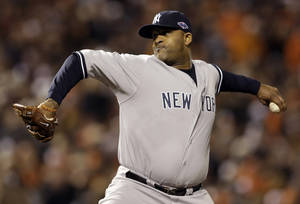 photo -   New York Yankees starting pitcher CC Sabathia throws to the Baltimore Orioles in the first inning Game 1 of the American League division baseball series on Sunday, Oct. 7, 2012, in Baltimore. (AP Photo/Patrick Semansky)