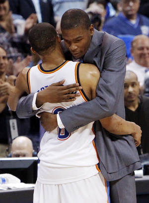 photo - Oklahoma City's Kevin Durant hugs Russell Westbrook (0) after Westbrook finished with a triple-double in the NBA basketball game between the Dallas Mavericks and the Oklahoma City Thunder at the Ford Center in Oklahoma City, March 2, 2009. The Thunder won 96-87. Durant did not play due to injury. PHOTO BY NATE BILLINGS, The Oklahoman