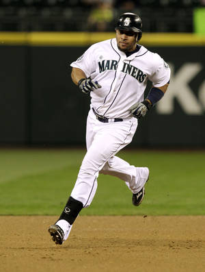 Photo - Miguel Olivo, while playing for the Seattle Mariners, Tuesday, Sept. 18, 2012, in Seattle. (AP Photo/Ted S. Warren)