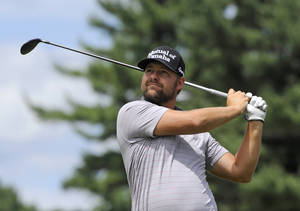 Photo - Ryan Moore watches his drive on the second hole during the third round of the Travelers Championship golf tournament in Cromwell, Conn., Saturday, June 21, 2014. (AP Photo/Fred Beckham)