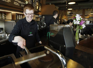 Photo -   Starbucks barista Linsey Pringle prepares a cup of coffee at a Starbucks Corp. store in Seattle.  AP File Photo  <strong>Ted S. Warren -  AP </strong>
