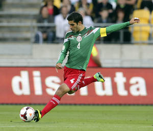 Photo - FILE - In this Nov. 20, 2013, file photo, Mexico's Rafael Marquez kicks the ball during his team's World Cup qualifying soccer match against New Zealand at Westpac Stadium, in Wellington, New Zealand. Marquez has made Mexico's World Cup roster for the fourth time. The 35-year-old defender, who captained Mexico at the 2010 tournament, was among 23 players selected Friday by Miguel Herrera, hired last October as El Tri's fourth coach in six weeks. (AP Photo/SNPA, John Cowpland) NEW ZEALAND OUT