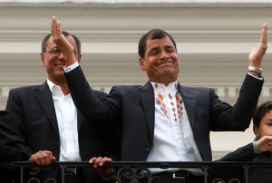 Photo - Ecuador's President and candidate for re-election Rafael Correa, top right, and vice presidential candidate Jorge Glass, top left, accompanied by relatives, celebrate after presidential elections in Quito, Ecuador, Sunday, Feb. 17, 2013. Although official results had still not been released, Correa celebrated his second re-election as Ecuador's president after an exit poll showed him leading by a wide margin. (AP Photo/Martin Jaramillo)