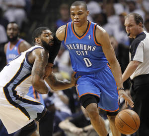 Photo - Oklahoma City Thunder guard Russell Westbrook (0) dribbles past Memphis Grizzlies guard O. J. Mayo, left, during the first half of Game 6 of a second-round NBA basketball playoff series on Friday, May 13, 2011, in Memphis, Tenn. (AP Photo/Wade Payne)