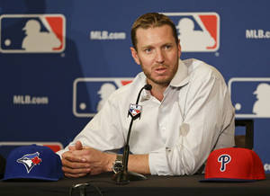 Photo - Two-time Cy Young Award winner Roy Halladay answers questions after announcing his retirement after 16 seasons in the major leagues with Toronto and Philadelphia at the MLB winter meetings in Lake Buena Vista, Fla., Monday, Dec. 9, 2013.(AP Photo/John Raoux)