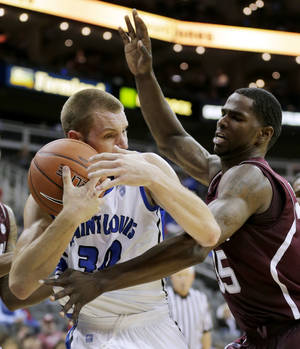 Photo -   Texas A&M forward Ray Turner, right, tries to steal the ball away from Saint Louis forward Jake Barnett (30) during the first half of an NCAA college basketball game, Monday, Nov. 19, 2012, in Kansas City, Mo. (AP Photo/Charlie Riedel)