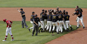 Photo - Oklahoma's Chase Simpson walks off the field as the University of Missouri celebrates the Big 12 baseball championship in Oklahoma City,  Sunday, May 27, 2012. Photo by Sarah Phipps, The Oklahoman.