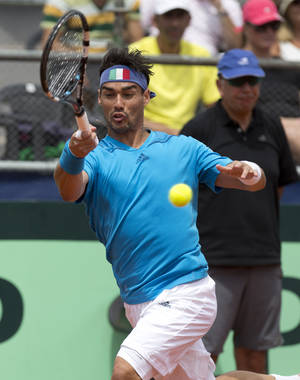 Photo - Italy's Fabio Fognini returns the ball to Argentina's Carlos Berlocq, during their Davis Cup singles match, in Mar del Plata, Argentina, Sunday, Feb. 2, 2014. (AP Photo/Eduardo Di Baia)