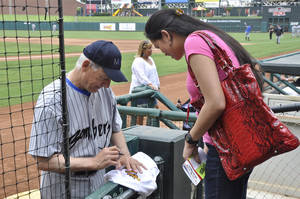 Photo -  Mark Harmon signs an autograph for Shiela Kilpatrick, of Enid, during the 14th Mark Harmon Celebrity Weekend at the Chickasaw Bricktown Ballpark. Photo by M. Tim Blake, for The Oklahoman  <strong>M. Tim Blake</strong>
