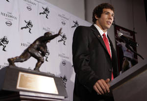 Photo - Oklahoma football player  Sam  Bradford answers questions for the media after being awarded the Heisman Trophy Saturday, Dec. 13, 2008 in New York. (AP Photo/Julie Jacobson)