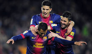 photo - FC Barcelona's Alexis Sanchez, from Chile, left, reacts after scoring with his teammate David Villa, right, against Cordoba during a Copa del Rey soccer match at the Camp Nou stadium in Barcelona, Spain, Thursday, Jan. 10, 2013. (AP Photo/Manu Fernandez)
