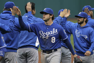 Photo -   Kansas City Royals third baseman Mike Moustakas (8), relief pitcher Tim Collins, right, and the rest of the Royals celebrate their 4-2 over over the Cleveland Indians in a baseball game in Cleveland on Thursday, April 26, 2012. (AP Photo/Amy Sancetta)