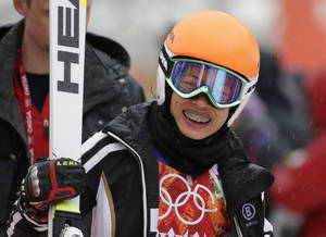 Photo - Violinst Vanessa Mae, starting under her father's name as Vanessa Vanakorn for Thailand, leaves after competing in the first run of the women's giant slalom at the Sochi 2014 Winter Olympics, Tuesday, Feb. 18, 2014, in Krasnaya Polyana, Russia. (AP Photo/Gero Breloer)