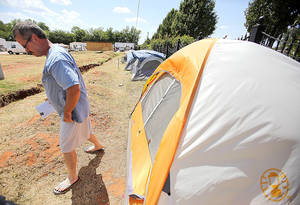Photo - Bobby Miller leaves his tent Wednesday at Hand Up Ministries.  Photo by Garett Fisbeck, The Oklahoman
