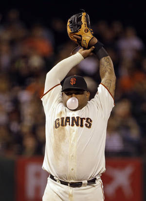 Photo - San Francisco Giants third baseman Pablo Sandoval stretches and blows a bubble while stretching in the eighth inning of their baseball game Tuesday, July 9, 2013, in San Francisco. (AP Photo/Eric Risberg)