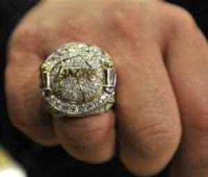 Photo - In this photo taken, Tuesday, Oct. 26, 2010, a Los Angeles Lakers championship ring is displayed following the ring presentation ceremony before the Lakers home-opening NBA basketball game against the Houston Rockets at the Staples Center in Los Angeles.(AP Photo/Daily News, John McCoy)