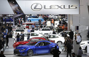 Photo -  People walk around the Lexus display Jan. 14 at the North American International Auto Show in Detroit. AP Photo  <strong>Carlos Osorio -  AP </strong>