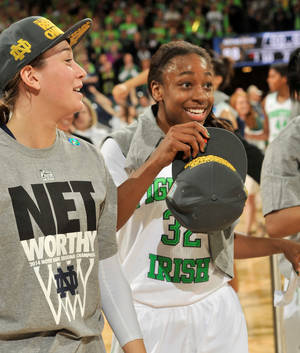 Photo - Notre Dame guards Jewell Loyd, right, and Michaela Mabrey celebrate their win over Baylor in a NCAA women's college basketball tournament regional final game at the Purcell Pavilion in South Bend, Ind Monday March 31, 2014. Notre Dame won 88-69. (AP Photo/Joe Raymond)