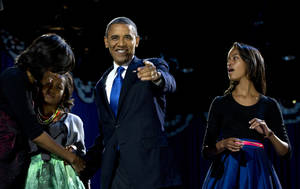 photo -   President Barack Obama, accompanied by first last Michelle Obama and daughters Malia and Sasha arrive at the election night party Wednesday, Nov. 7, 2012, in Chicago. Obama defeated Republican challenger former Massachusetts Gov. Mitt Romney. (AP Photo/Carolyn Kaster)