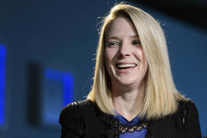 Photo - Marissa Mayer, Chief Executive Officer of Yahoo!,  smiles  during the 43rd Annual Meeting of the World Economic Forum, WEF, in Davos, Switzerland, Friday, Jan. 25, 2013.  (AP Photo/Keystone/Laurent Gillieron)