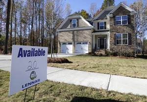 Photo - FILE - In this Nov. 14, 2013 file photo, a home is advertised for sale in Matthews, N.C. Freddie Mac, the mortgage company, releases weekly mortgage rates on Thursday, Jan. 9, 2014. (AP Photo/Chuck Burton, File)