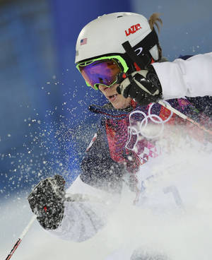 Photo - United States' Hannah Kearney runs the course in the women's moguls final at the Rosa Khutor Extreme Park, at the 2014 Winter Olympics, Saturday, Feb. 8, 2014, in Krasnaya Polyana, Russia. (AP Photo/Sergei Grits)
