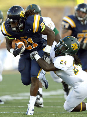 Photo - UCO's Joshua Birmingham tries to get by Missouri Southern's Demon Haire during the college football game between the University of Central Oklahoma and Missouri Southern at Wantland Stadium in Edmond, Okla., , Thursday, Aug. 30, 2012. Photo by Sarah Phipps, The Oklahoman KOD