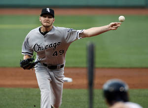 Photo - Chicago White Sox starting pitcher Chris Sale delivers to the Boston Red Sox in the first inning of a baseball game at Fenway Park in Boston, Wednesday, July 9, 2014. (AP Photo/Elise Amendola)
