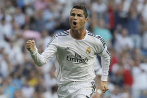 Photo - Real Madrid's Cristiano Ronaldo celebrates his goal during a Spanish La Liga soccer match against Getafe at the Santiago Bernabeu stadium in Madrid, Spain, Sunday, Sept. 22, 2013. (AP Photo/Andres Kudacki)