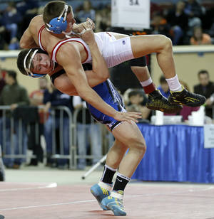photo - Deer Creek's Cole Pacheco , left, wrestles Collinsville's Zach Abkemeier during the Class 5a 170-pound championship match in the state wrestling championships at the State Fair Arena in Oklahoma City, Saturday, Feb. 23, 2013. Photo by Bryan Terry, The Oklahoman