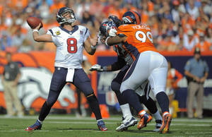 Photo -   Houston Texans quarterback Matt Schaub (8) throws for a touchdown against the Denver Broncos in the second quarter of an NFL football game Sunday, Sept. 23, 2012, in Denver. (AP Photo/Jack Dempsey)