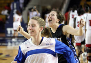 Photo - Edmond Deer Creek's Bayli Blanchard right) and other teammates celebrate following their win over East Central, in the second round of their 5A state basketball playoff game, at the Mabee Center, in Tulsa, on Friday, March 8, 2013. CORY YOUNG/Tulsa World