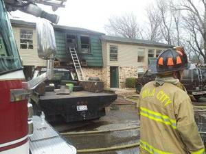 photo - Fire crews work outside the Brighton Place Apartments near Interstate 240 and Walker. No injuries were reported. Photo by Jaclyn Cosgrove, The Oklahoman